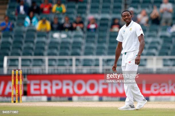 South African bowler Kagiso Rabada celebrates the dismissal of Australian batsman Nathan Lyon on the third day of the fourth Test cricket match...