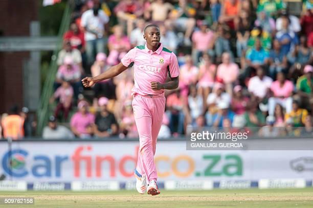 South African bowler Kagiso Rabada celebrates the dismissal of England's batsman Chris Woakes during the fourth One Day International cricket match...