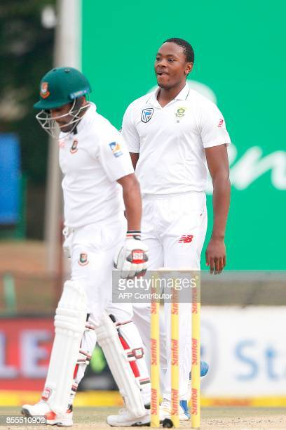 South African bowler Kagiso Rabada celebrates the dismissal of Bangladesh batsman Imrul Kayes during the second day of the first Test Match between...