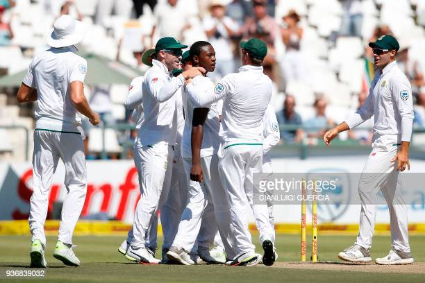 South African bowler Kagiso Rabada celebrates the dismissal of Australian batsman David Warner during the second day of the third Test cricket match...