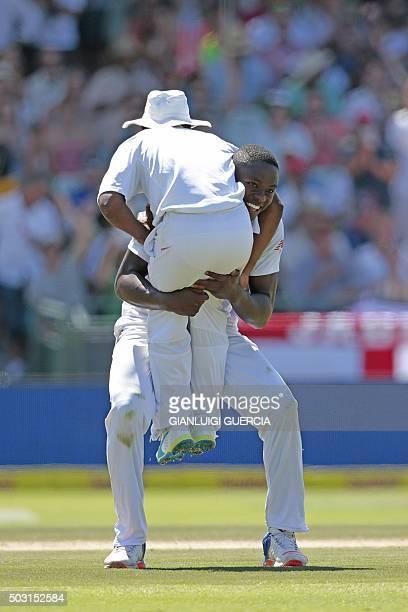TOPSHOT South African bowler Kagiso Rabada congratulates South Africa's fielder Temba Bavuma who caught out England batsman Nicholas Compton during...