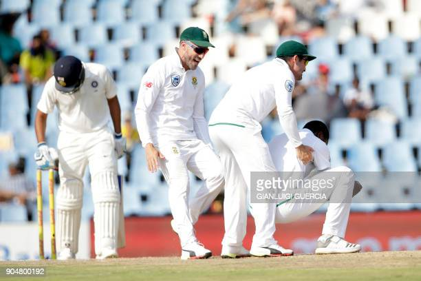South African bowler Kagiso Rabada Dean Elgar and Faf du Plessis celebrate the dismissal of Indian batsman Rohit Sharma during the second day of the...