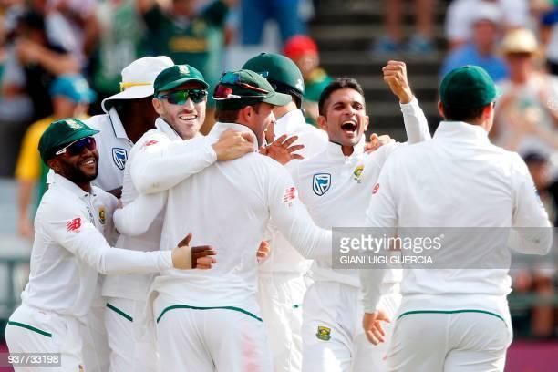 South African bowler Keshav Maharaj celebrate the dismissal of Australian batsman Usman Khawaja during the fourth day of the third Test cricket match...