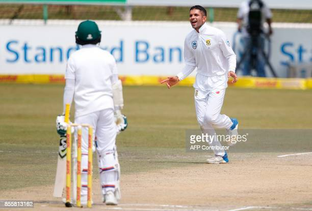 South African bowler Keshav Maharaj celebrates after his dismissal of Bangladesh batsman Mominul Haque during the third day of the first Test cricket...