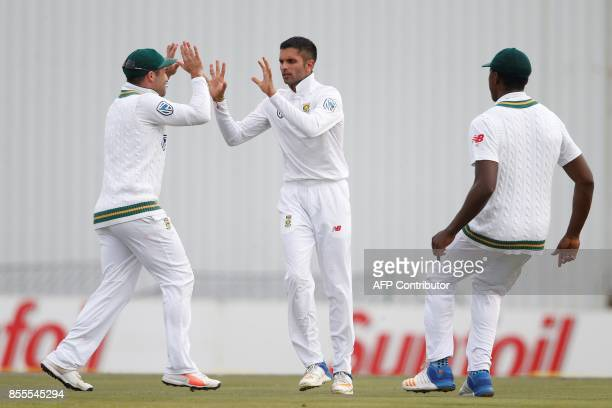 South African bowler Keshav Maharaj celebrates the dismissal of Bangladesh batsman Mushfiqur Rahim during the second day of the first Test Match...