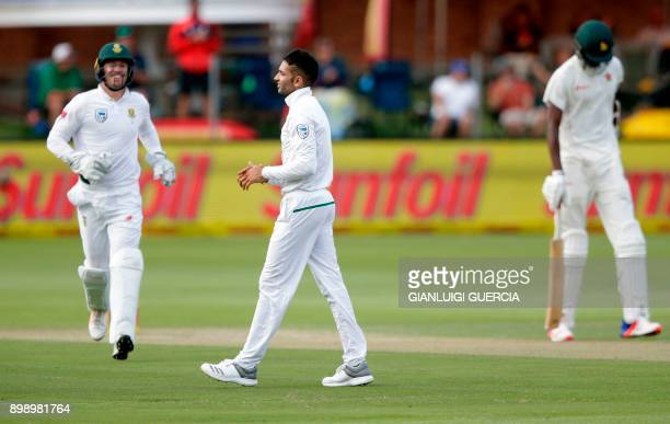 South African bowler Keshav Maharaj celebrates the dismissal of Zimbabwean batsman Blessing Muzarabani during the second day of the daynight Test...
