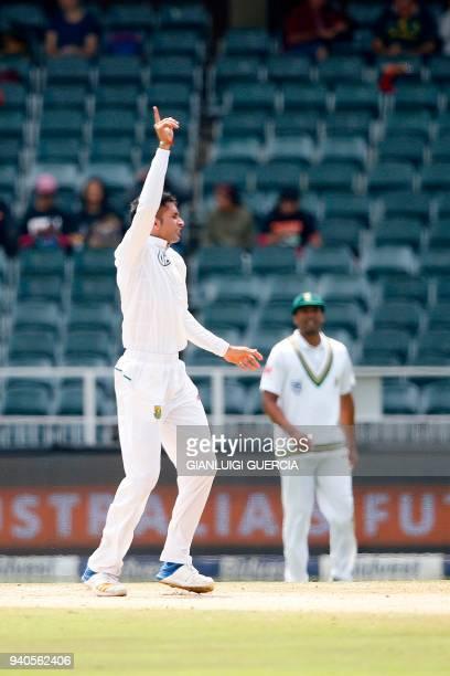 South African bowler Keshav Mahraj celebrates the dismissal of Australian batsman Pat Cummins on the third day of the fourth Test cricket match...