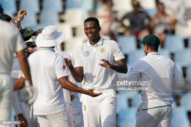 South African bowler Lungi Ngidi and teammates celebrates the dismissal of Indian batsman Parthiv Patel during the second day of the second Test...