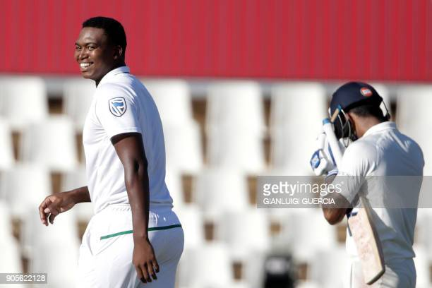 South African bowler Lungi Ngidi celebrates the dismissal of Indian batsman Lokesh Rahul during the fourth day of the second Test cricket match...