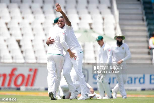 South African bowler Lungi Ngidi celebrates the dismissal of Indian batsman and Captain Virat Kohli during the first day of the third test match...