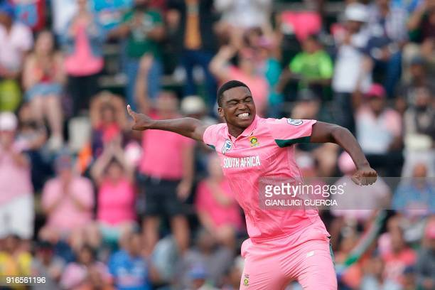 South African bowler Lungi Ngidi celebrates the dismissal of Indian batsman Ajinkya Rahane during the fourth One Day International cricket match...