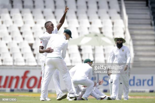 South African bowler Lungi Ngidi celebrates with teammates the dismissal Indian batsman and Captain Virat Kohli during the first day of the third...