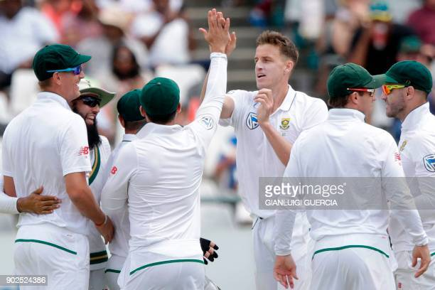 South African bowler Morne Morkel celebrates the dismissal of Indian batsman Shikhar Dhawan during the fourth day of the first Test cricket match...