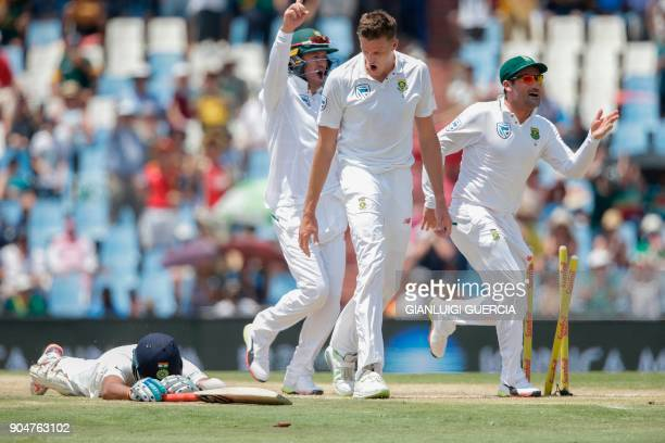 TOPSHOT South African bowler Morne Morkel celebrates the dismissal of Indian batsman Cheteshwar Pujara during the second day of the second Test...