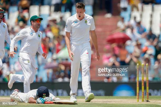 South African bowler Morne Morkel celebrates the dismissal of Indian batsman Cheteshwar Pujara during the second day of the second Test cricket match...