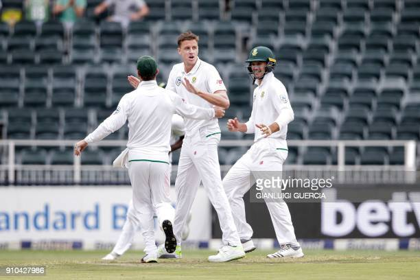 South African bowler Morne Morkel celebrates the dismissal of Indian Batsman Cheteshwar Pujara during the third day of the third test match between...