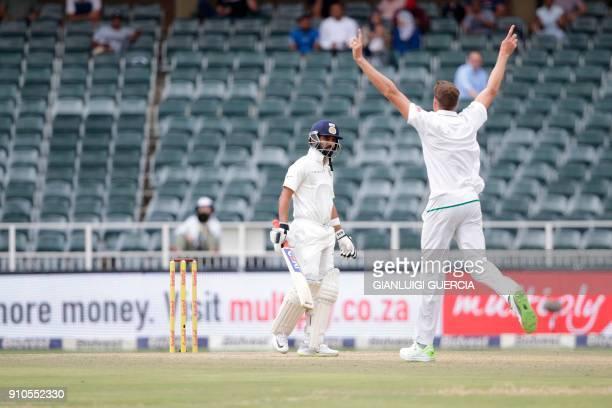 South African bowler Morne Morkel celebrates the dismissal of Indian batsman Ajinkya Rahane during the third day of the third test match between...