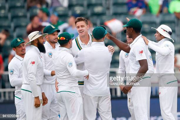 South African bowler Morne Morkel celebrates the dismissal of Australian batsman Joe Burns on the fourth day of the fourth Test cricket match between...