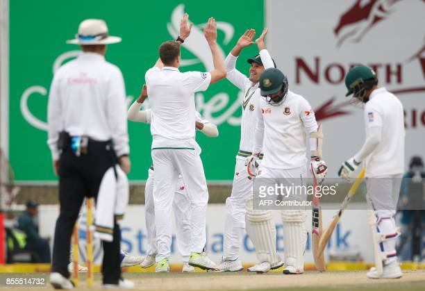 South African bowler Morne Morkel celebrates the dismissal of Bangladesh batsman Liton Das during the second day of the first Test Match between...