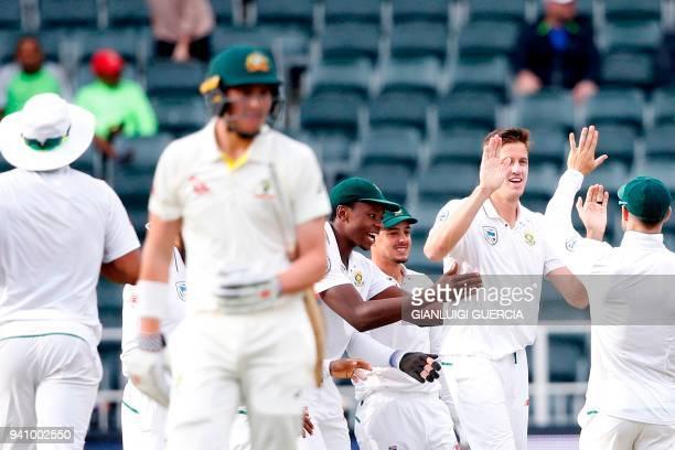 South African bowler Morne Morkel celebrates the dismissal of Australian batsman Matt Renshaw on the fourth day of the fourth Test cricket match...