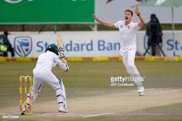 South African bowler Morne Morkel celebrates the dismissal of Bangladesh batsman Mominul Haque during the fourth day of the first Test Match between...