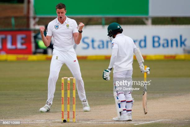 South African bowler Morne Morkel celebrates the dismissal of Bangladeshi batsman Mominul Haque during the fourth day of the first Test Cricket Match...