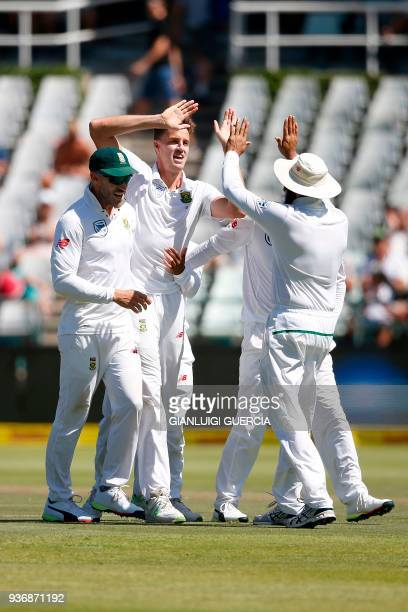 South African bowler Morne Morkel celebrates the dismissal of Australian batsman Steven Smith during the second day of the third Test cricket match...