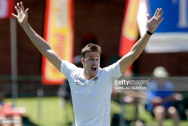 South African bowler Morne Morkel celebrates the dismissal of Zimbabwean batsman Sikandar Raza during the second day of the day night Test cricket...