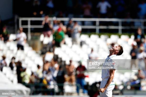 TOPSHOT South African bowler Morne Morkel celebrates the dismissal of Australian batsman Shaun Marsh and his 300th wicket in his test career during...