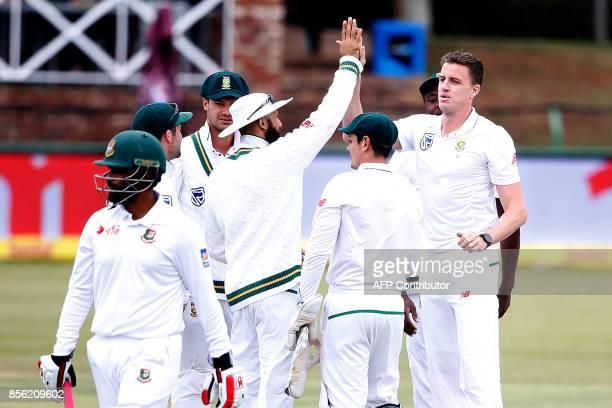 South African bowler Morne Morkel celebrates the dismissal of Bangladesh batsman Tamim Iqbal during the fourth day of the first Test Match between...