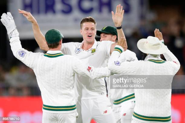 South African bowler Morne Morkel celebrates the dismissal Zimbabwean batsman Hamilton Masakadza during the first day of the day night Test cricket...