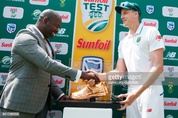 South African bowler Morne Morkel receives a trophy as he played his last match in Test Cricket after winning the fifth Test cricket match between...