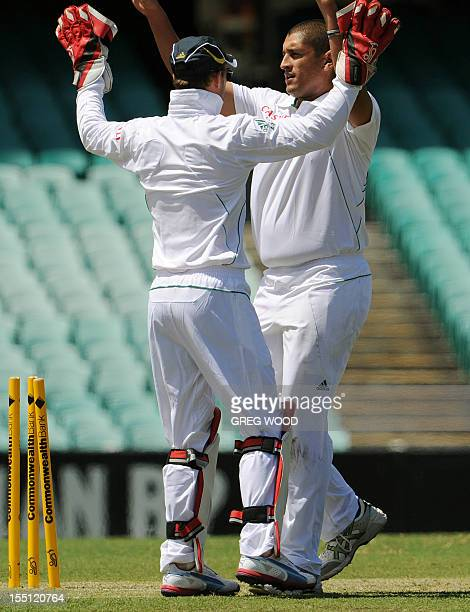 South African bowler Rory Kleinveldt celebrates with teammate AB Devilliers after taking the wicket of Australia's batsman Phillip Hughes during the...