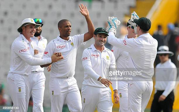 South African bowler Vernon Philander celebrates after taking the wicket of Indian batsman Shikhar Dhawan during the first test match, at PCA...