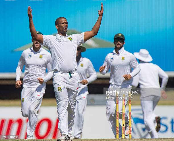 South African bowler Vernon Philander celebrates the dismissal of New Zealand batsman Mitchell Santner on the third day of the second Cricket Test...