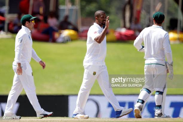 South African bowler Vernon Philander celebrates the dismissal of Indian batsman Cheteshwar Pujara during the fifth day of the second Test cricket...