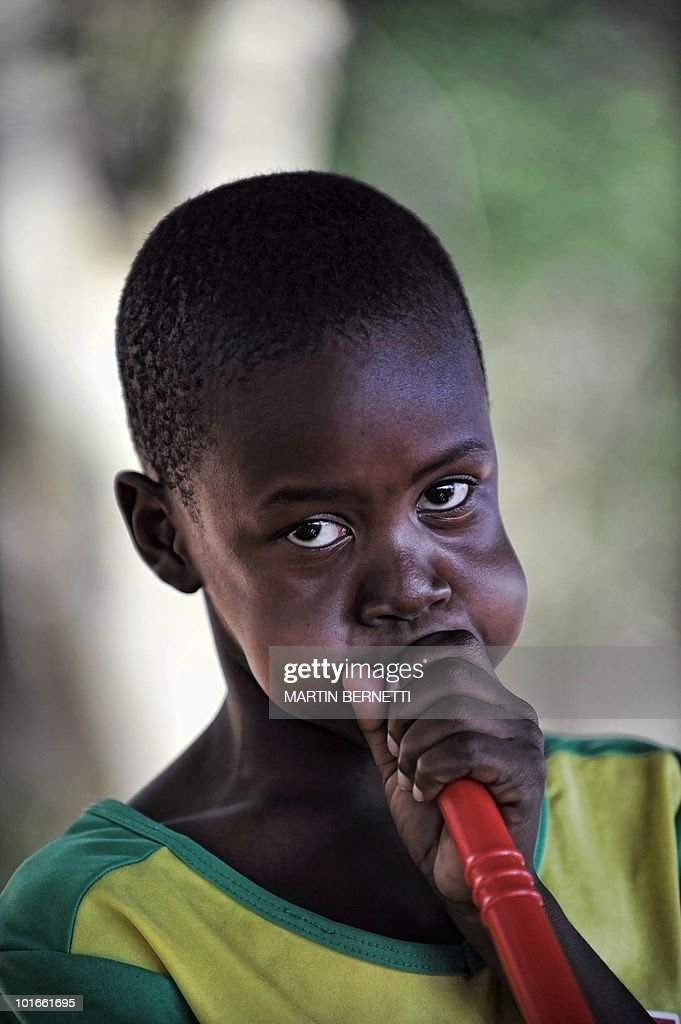 A South African boy plays a vuvuzela, a large coloured plastic trumpet, on the arrival of the Chilean national team at the airport in Nelspruit on June 6, 2010. Chile will play against Honduras in their first South Africa 2010 World Cup match on June 16. AFP PHOTO / Martin BERNETTI