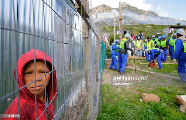A South African boy watches as council workers break down illegal structures Violence broke out in Hout Bay near Cape Town South Africa on 21...