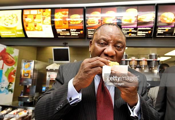 South African businessman Cyril Ramaphosa eats a McDonalds' burger at a McDonalds' restaurant on March 17 2011 in Johannesburg South Africa Ramaphosa...