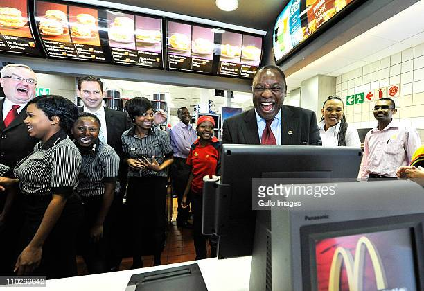 South African businessman Cyril Ramaphosa shares a joke with staff at a McDonalds' restaurant on March 17 2011 in Johannesburg South Africa Ramaphosa...