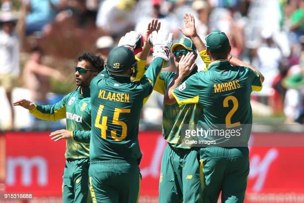South African captain Aiden Markram is congratulated for taking the catch to get Shikhar Dhawan of India's wicket during the 3rd Momentum ODI match...