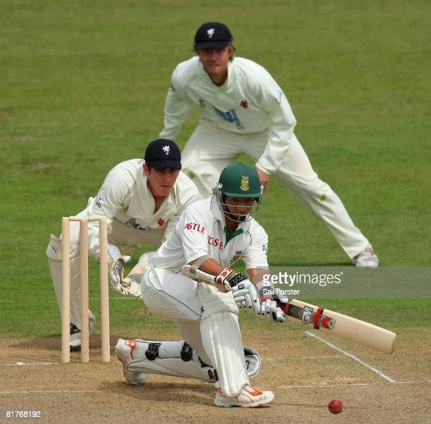 South African captain Ashwell Prince sweeps a ball to the boundary watched by Somerset wicketkeeper Craig Kieswetter during day two of the tour match...