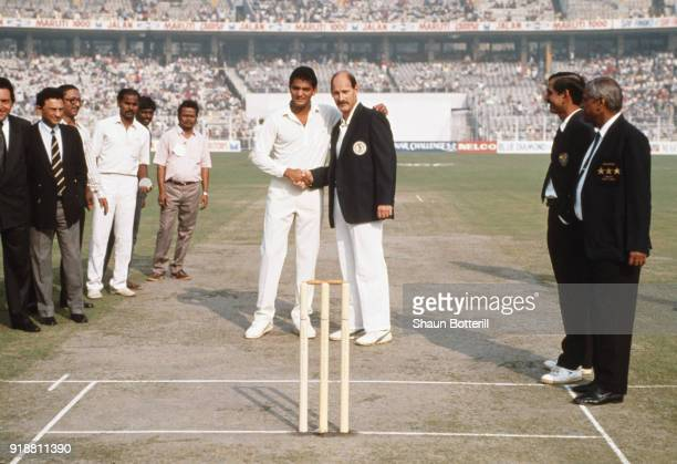 South African captain Clive Rice shakes hands with India captain Mohammad Azharuddin at the coin toss before the 1st ODI between India and South...