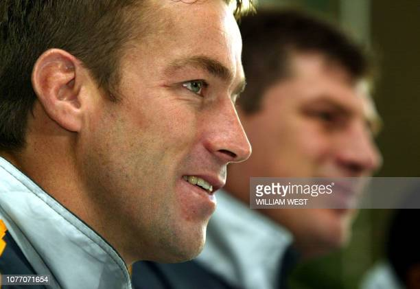 South African captain Corne Crige and coach Rudolph Straeuli speak to the media in Brisbane 01 August 2003. South African face the Australian...