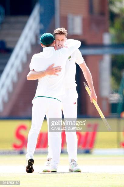 South African Captain Faf du Plessis and bowler Morne Morkel celebrate winning the fifth Test cricket match between South Africa and Australia and...
