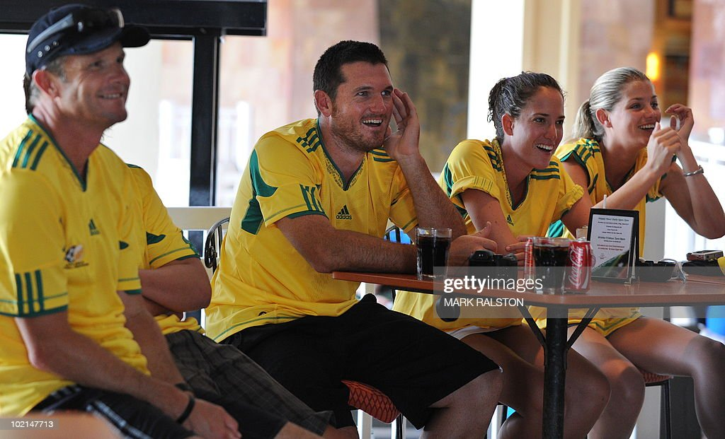 South African captain Graeme Smith (2nd L) and coach Corrie van Zyl (L) watch the South Africa versus Uruguay World Cup football match as they relax before the second test at the Warner Park ground in the St Kitts capital of Basseterre on June 16, 2010. South Africa have taken a 1-0 lead in the three-Test series, with the second test beginning on June 18. AFP PHOTO/Mark RALSTON