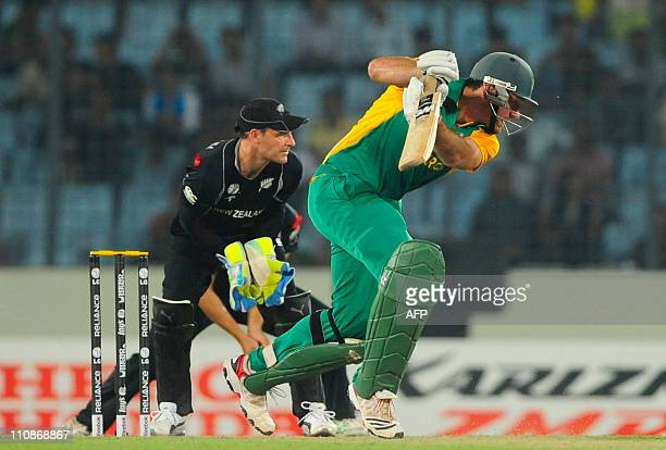 South African captain Graeme Smith plays a shot as New Zealand wicketkeeper Brendon McCullum looks on during the quarterfinal match of the ICC...