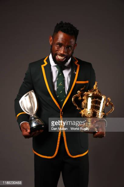 South African captain Siya Kolisi poses with the Webb Ellis Cup and the World Rugby Team of the Year Award during the World Rugby Awards 2019 at the...