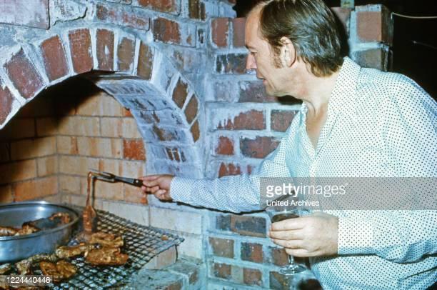 South African cardiac surgeon Christiaan Barnard at a BBQ in Cape Town South Africa 1974