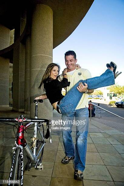 South African celebrity couple Amor Vittone and Joost van der Westhuizen pose together on May 15 2007 in Johannesburg South Africa